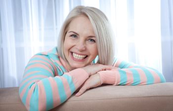 broadly smiling middle-aged woman