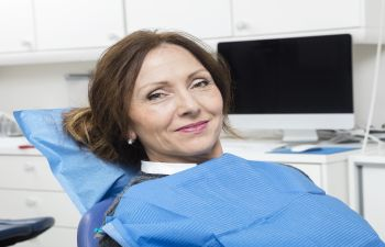 mature woman in a dental chair