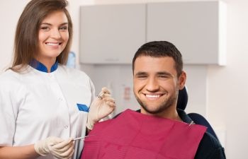 man in a dental chair during a dental appointment