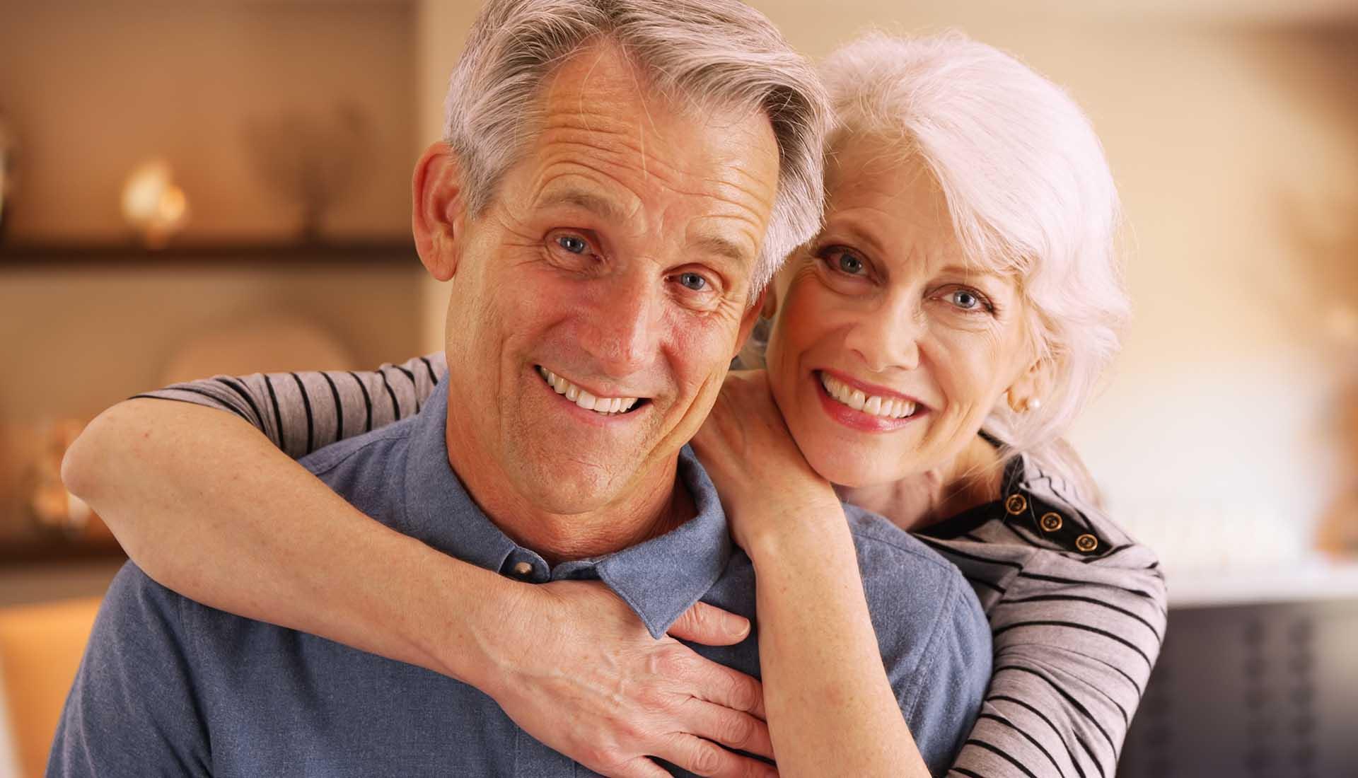 happy senior couple with perfect smiles