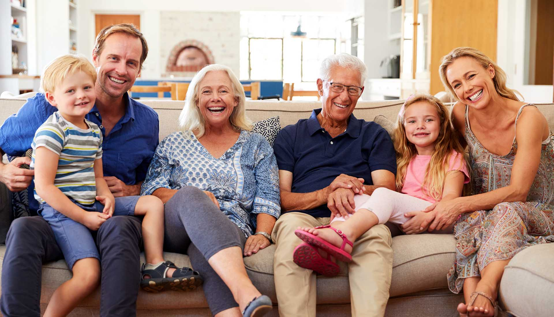 happy three-generation family enjoying time together at home