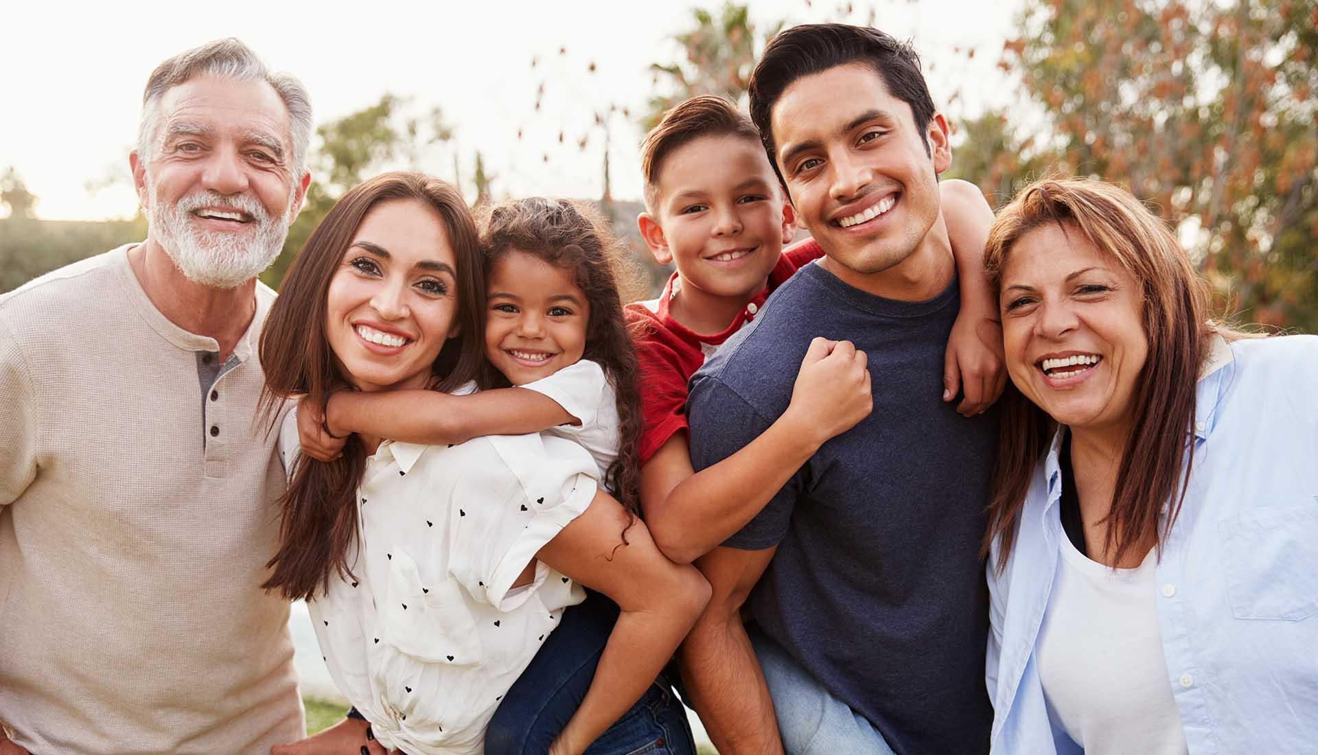 happy three generation Hispanic family in the park