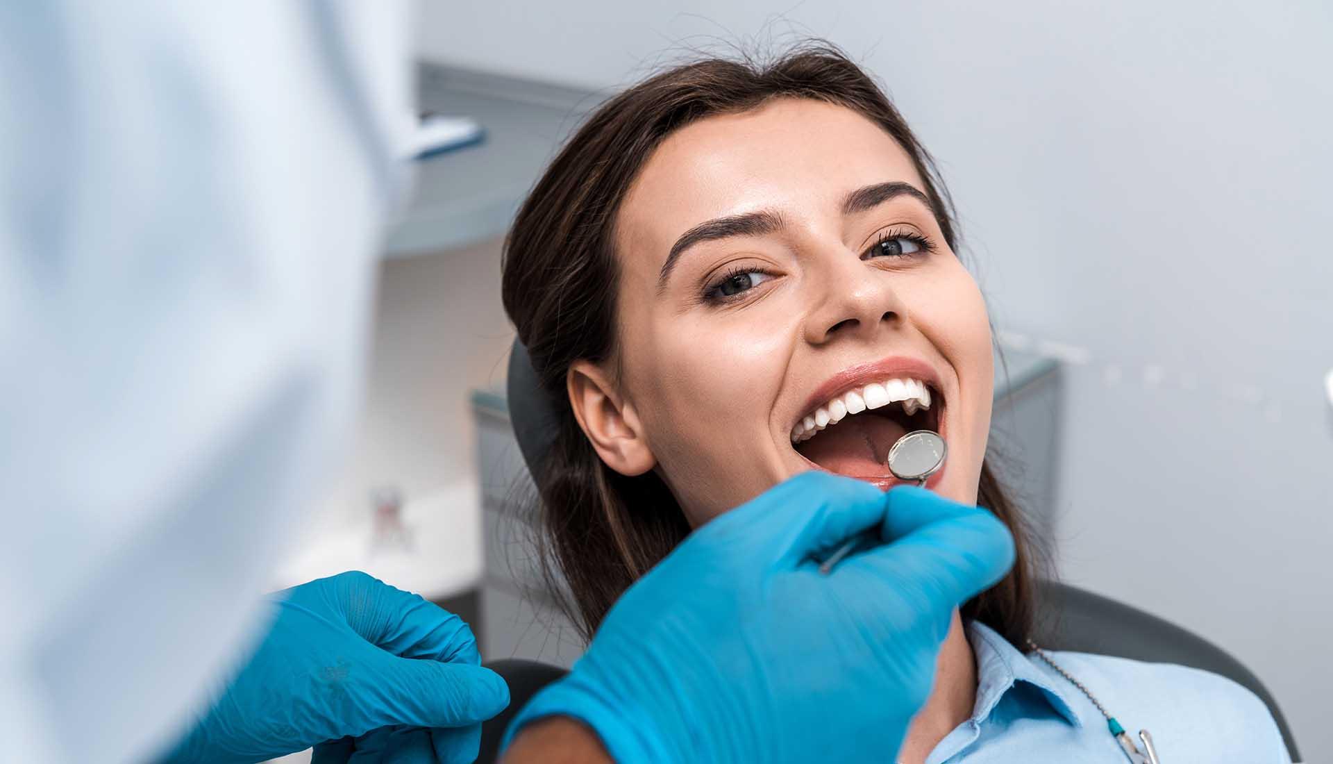 woman in a dental chair during a dental checkup